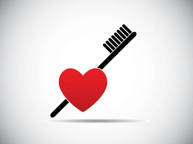 escova e coração ícone